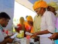 Sri Swami Madhavananda Austria Hospital in Jadan: Hospital staff issuing medicine.